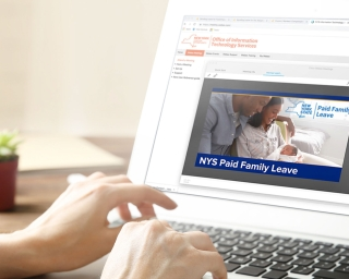 Laptop displaying a Paid Family Leave webinar